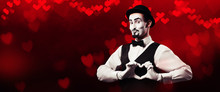 Mime Artist Showing Love Sign With Hands On Red Background With Heart Bokeh. Valentine's Day Concept.