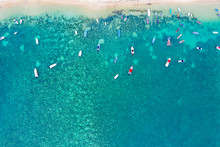 Aerial By Drone Of Boats In The Turquoise Water Of Lagoon Front Of Mont Choisy Beach, North-west Coast, Mauritius