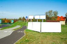 Six Blank Advertising Billboard Near The Sidewalk And Bicycle Path