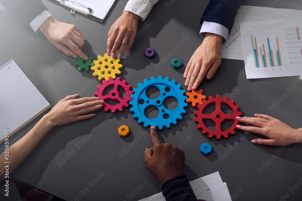 Obraz Business team connect pieces of gears. Teamwork, partnership and integration concept fototapeta, plakat