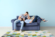 canvas print picture - Young couple resting on sofa at home