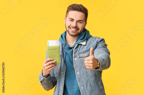 Obraz Handsome male tourist on color background - fototapety do salonu