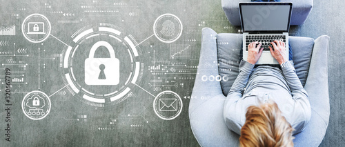 Fotografía Internet network security concept with man using a laptop in a modern gray chair