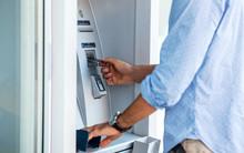 Man Using An Cash Dispenser On...