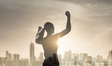 Strong Confident Young Female In The City Flexing Her Arms. People Victory, Confidence And Achieving Goals Concept.