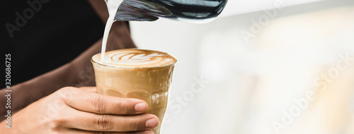 Fotografie, Obraz Professional barista making latte art coffee