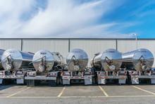 Row Of Shiny Metal Tanker Trucks