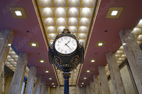 Fototapeta  Large ornate clock in art deco style banking hall obraz