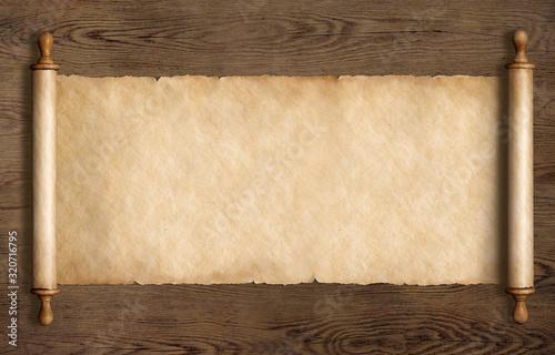 Obraz parchment scroll on wood table 3d illustration - fototapety do salonu