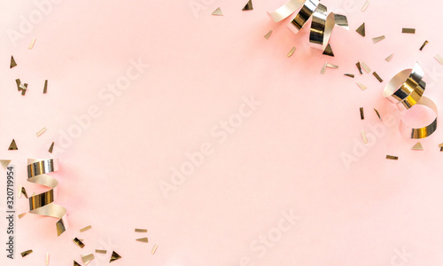 Fototapeta close up on group of silver color of rolling ribbon and confetti on pink background with copy space for valentine's day ,carnival , birthday and anniversary, concept design obraz