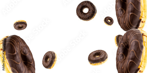 Fototapeta Donut cookies. Chocolate glazed sweet doughnut in motion falling on white background. Sweet icing sugar food. obraz