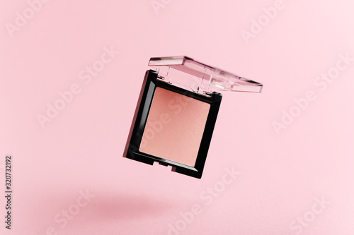 A flying packaging of pink blush on a pink background Canvas Print