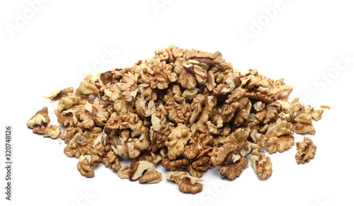 Fotomural Unshelled walnuts pile isolated on white background