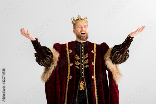 handsome king with crown screaming isolated on grey Fotobehang