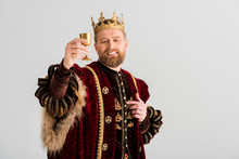 Smiling King With Crown Holding Cup Isolated On Grey