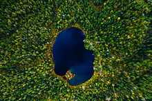 Aerial View Of Small Blue Lake...