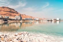 Dead Sea Salt Shore. Salt On Background Of The Sea And The Coastal Resort Town Ein Bokek, Israel