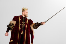 King With Crown Fighting With Sword Isolated On Grey