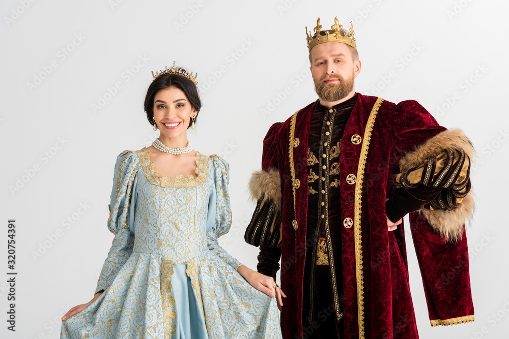 Fototapeta smiling queen and king with crowns isolated on grey