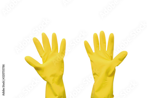 Photo Household rubber gloves in yellow on an isolated background.