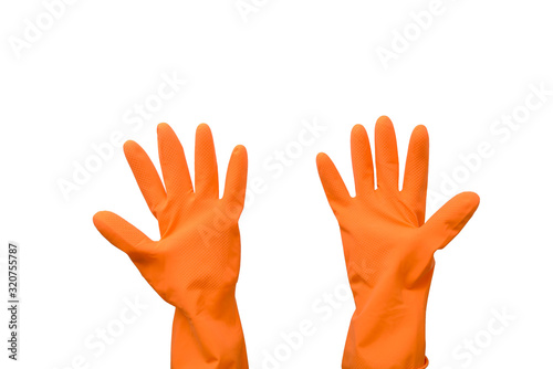 Household rubber gloves in orange on an isolated background. Canvas Print