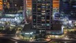 Residential and office buildings in Jumeirah lake towers district morning timelapse with shops, restaurants and walkways in Dubai. Aerial panoramic view from above with modern skyscrapers and traffic