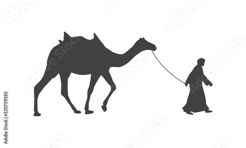 Silhouette of camel with saddle and drover. Tablou Canvas