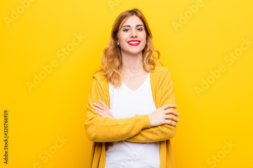 young pretty blonde woman looking like a happy, proud and satisfied achiever smi Wallpaper Mural