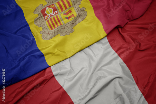 waving colorful flag of peru and national flag of andorra. Canvas Print