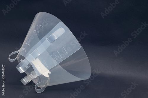 Obraz Plastic protective collar for an animal close up - fototapety do salonu
