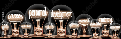 Light Bulbs with Personal Development Concept