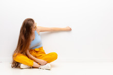 Yound Blonde Woman Standing An...