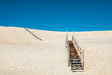 Wooden Stairs Over Sand Dune W...