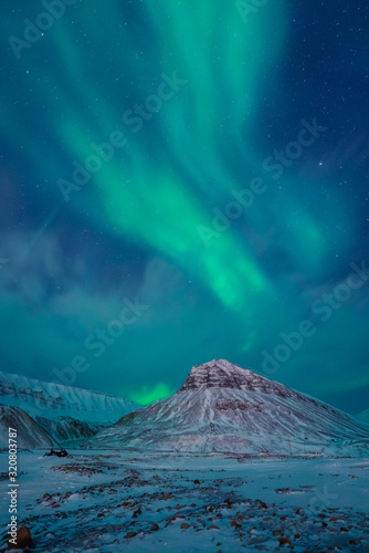 The polar arctic Northern lights aurora borealis sky star in Norway Svalbard in Longyearbyen  with the  mountains Fototapeta