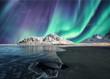 canvas print picture - Aurora Borealis, Northern Lights Above on snowy mountain in Skagsanden Beach at Lofoten Islands