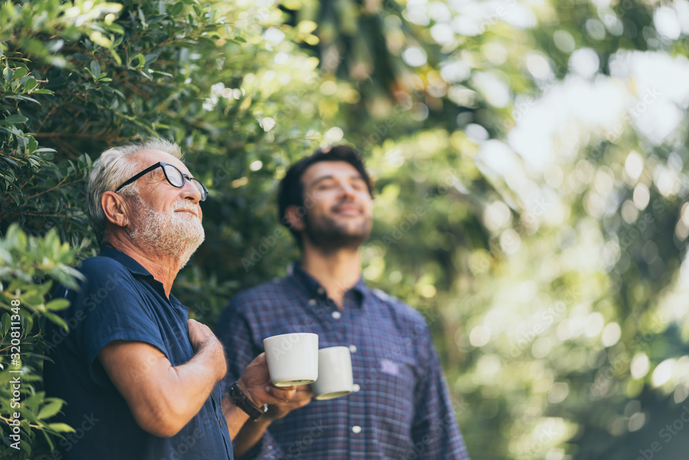 Fototapeta Old father and son, Morning coffee in a garden