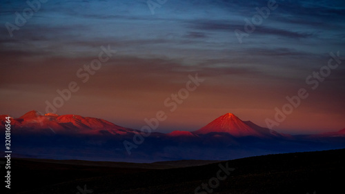 Fotografie, Obraz Sunset illuminates Sairecabur and Licancabur volcanoes, Atacama Desert Antofagas