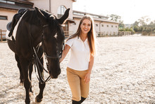 Beautiful Woman With Horse In Countryside