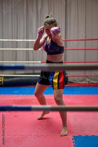 Female kickboxer shadow boxing Canvas Print