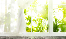 Wooden Table And View Through Window On Garden In Morning. Springtime