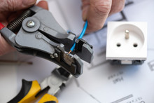 Electrician Stripping A Wire