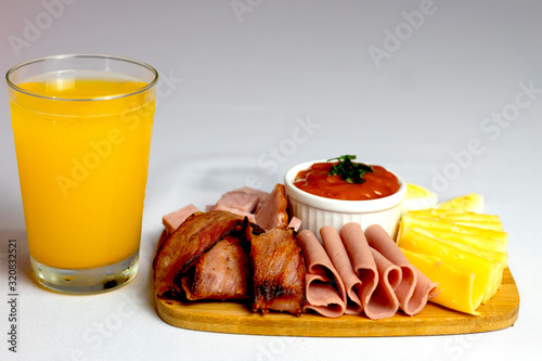 Appetizer with cheese, ham, bacon, salami, cachaça and sauce © vaPRIME