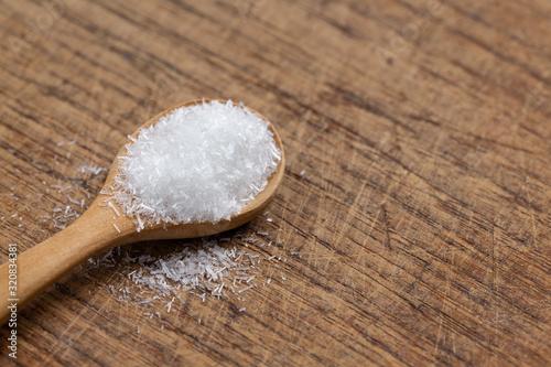 Fotografie, Obraz monosodium glutamate, MSG on wooden spoon