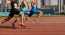 Men Sprinters Run On Track Sta...