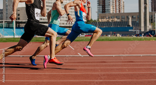 mata magnetyczna men sprinters run on track stadium in athletics competition