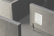 Man Lost In A Complex Maze, Observing The Map To Find The Way Out