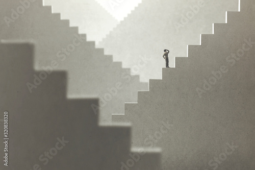 Fototapeta surreal concept of a man rising stairs to try to reach the top obraz