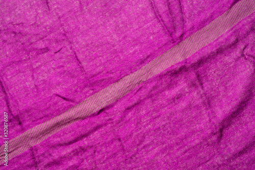 Fuchsia color wrinkled fabric texture. Diagonal line - 320876587