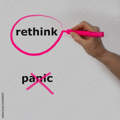Photo The word rethink is circled with a pink pencil by a hand with a bubble