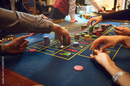 Fotomural Roulette table chips in a casino. Gamblers make bets in a casino.